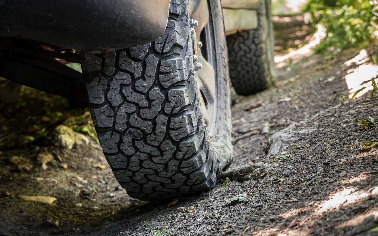 a subaru forester off roading with all terrain tires